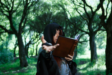 Picture of witch with magic book