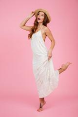 Full length portrait of a pretty girl in summer dress