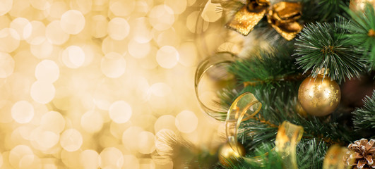 Christmas tree branch with blurred golden background