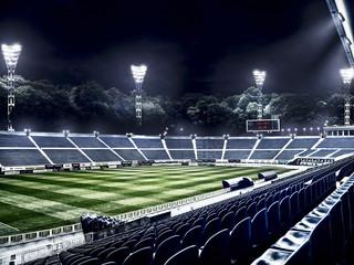 empty soccer stadium in light rays at night