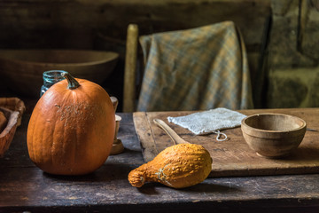 pumpkin and squash on pioneer table