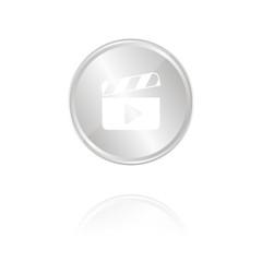 Filmklappe mit Abspielen-Symbol - Silber Münze mit Reflektion