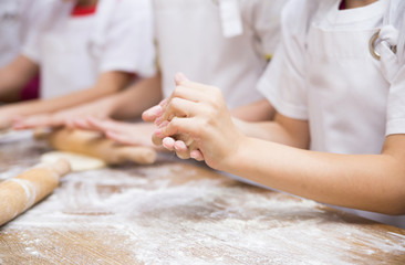 Production of flour products. Hands close up