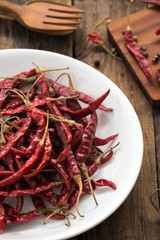 Red Dried Chillies or Dry chillies on wood