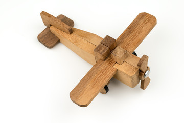 isolated wooden toy airplane , travel flight transport object on white background