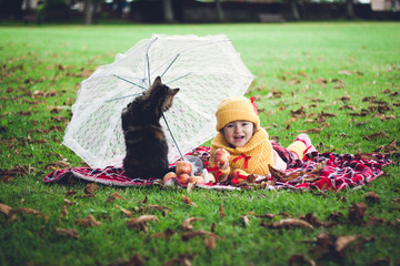 The girl with an umbrella and cat
