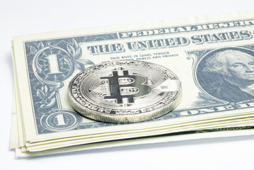 Dollar banknote with silver bitcoin, white background