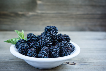 Blackberries in a white bowl.