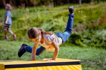 Girl Child Practicing Parkour Gymnastics Outside
