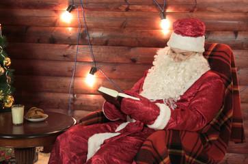 Santa Claus reads a book