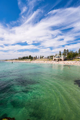 Cottesloe Beach on a warm Spring day with high cloud. Perth, Western Australia, Australia.