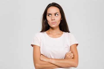Portrait of an upset unsatisfied asian woman standing