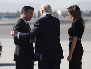 U.S. President Trump is greeted by Sandoval as he arrives in Las Vegas, Nevada