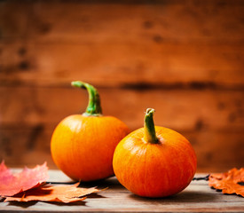 Autumn Pumpkin Happy Thanksgiving Background with  orange pumpkins on wooden table with copyspace.