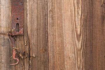 Old medieval lock on wooden castle door