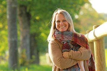 Happy  mature woman enjoys leisure time in autumn