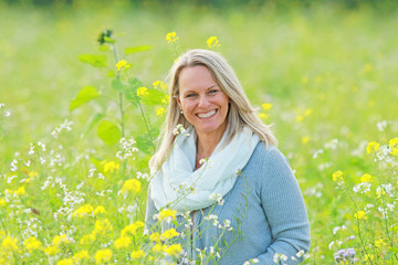 happy mature woman  in a flowerfield