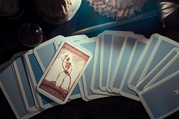 Tarot card /  View of tarot card on the table under candlelight. The Death. Dark tone.