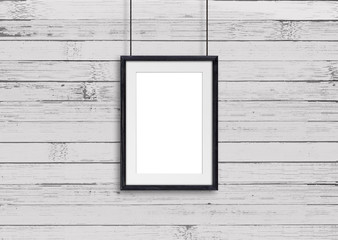 Black  wooden frame, hanging on cords against old painted panels wall. Gallery style decor mock up