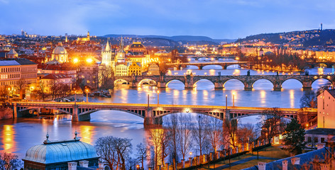 Photo sur Aluminium Prague Classic view of Prague at Twilight, panorama of Bridges on Vltava, view from above, beautiful bridges vista. Winter scenery. Prague is famous and extremely popular travel destination. Czech Republic.