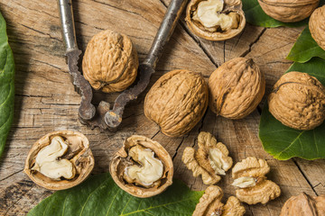 fresh walnuts on an old wooden table
