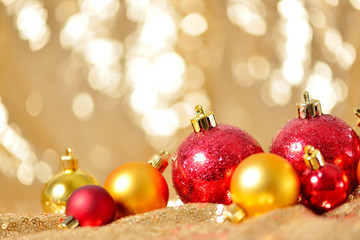 Christmas background, new year close up red and gold decoration balls on glitter abstract blurred holiday bokeh background