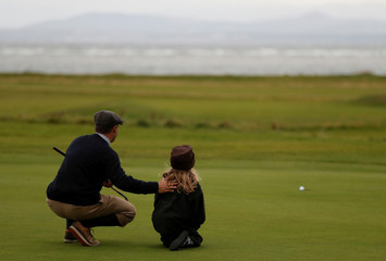 Bo Turocy lines up a putt on the 18th hole during the World Hickory Open at Kilspindie Golf Course in Aberlady