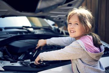 little girl repairing the car