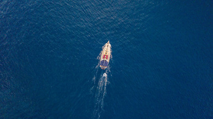 Aerial view of sailing boat on open sea.