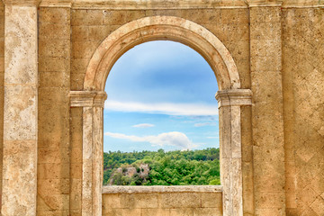 Italian view through the arch window, Tuscany, Italy