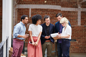 Group of millennials in meeting at office