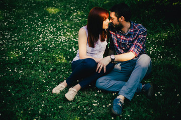 Young couple on the grass