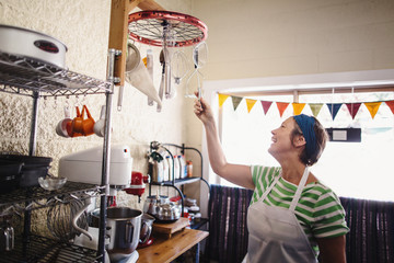 Happy baker reaching for utensil