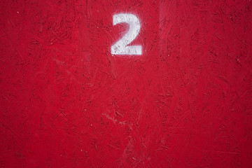 horizontal number on a red wall