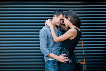 Happy couple kissing outdoor