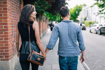 Happy couple walking outdoor