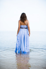 Woman in a Beautiful Dress Walking into the Ocean