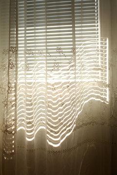 Shadows on a white curtain