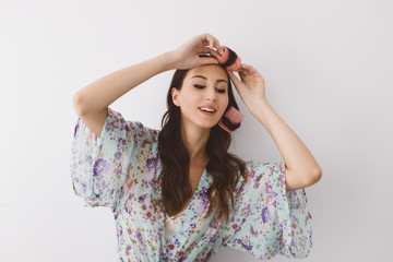 Beautiful Woman Putting Curlers in Her Hair