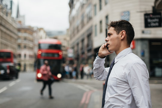 Businessman using mobile phone in the City