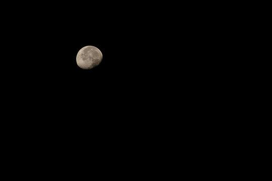 Waning gibbous moon on a dark night