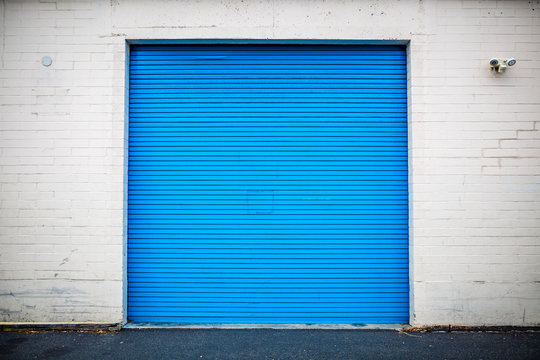 Blue Industrial Roll Up Door Inset in Brick Wall