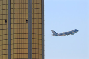 Air Force One departs Las Vegas past the broken windows on the Mandalay Bay hotel, where shooter Stephen Paddock conducted his mass shooting along the Las Vegas Strip in Las Vegas