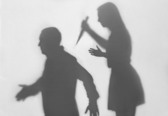 Silhouette of woman trying to kill her husband on white background. Domestic violence concept Wall mural