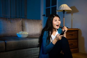 female student watching football championship