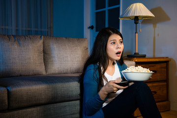 lovely young woman holding popcorn snack