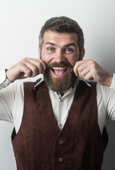 Man with long beard and mustache on happy face.