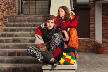 Young fashion hipster couple on the steps