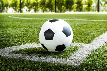 soccer Football on Corner kick line of ball and a soccer field , football field , background texture