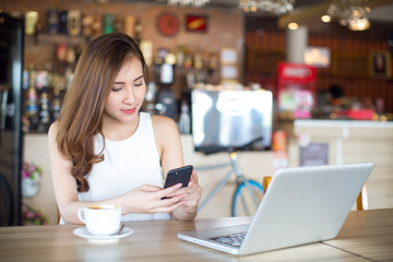 mart Asia woman using smart phone and laptop, Social media life style of new generation for living, internet of things conceptual,